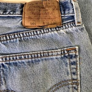Levi's distressed button fly jeans